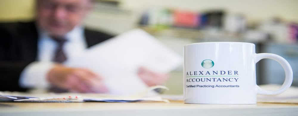 Desk Image with Branded Mug - Alexander Accountancy